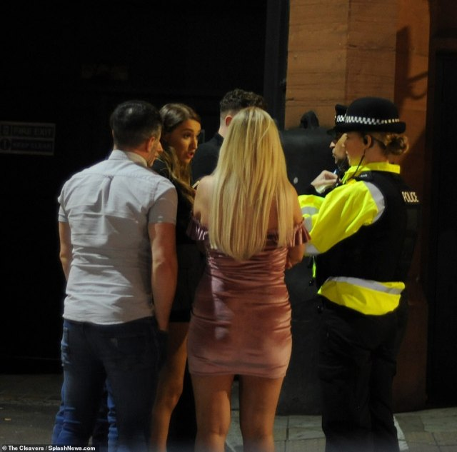 GREATER MANCHESTER: Police chat to revellers in the streets of Greater Manchester on Saturday night, with new restrictions on social gatherings coming in from Monday