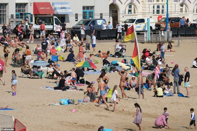 In Bournemouth, many flocked to the beach as Briton enjoys a heatwave, with many meeting up in large groups for the day out