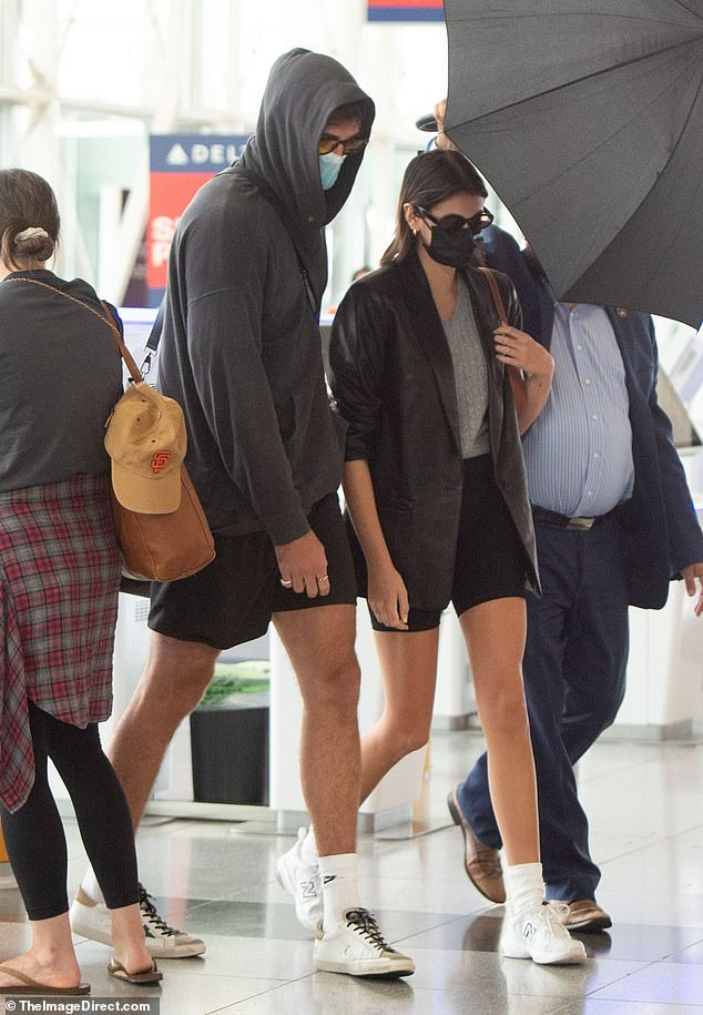 Sticking together: The pair both sported CDC-recommended face masks and sunglasses, as they walked around inside the airport's lobby