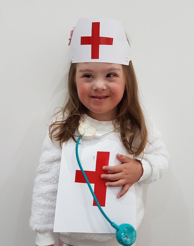 Thank You By Wendy Huson, Liverpool. Wendy says: Our little girl, Amelia, has Down's syndrome. I made her a very simple nurses outfit and then took the picture in our kitchen to celebrate International Nurses Day. We wanted to put a special post on her social media accounts thanking all of the nurses for the amazing work they do every day and especially during the Covid 19 pandemic'