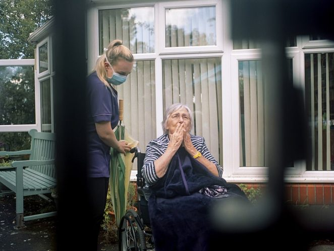 Granny's 90th by Georgia Koronka. A medic is seen attending to an elderly person in a wheelchair