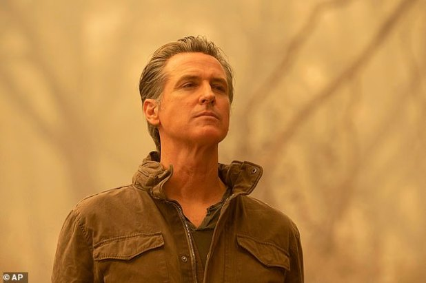 According to California Gov. Gavin Newsom (pictured Friday after visiting the North Complex fire zone in Battee County), the West Coast Wildfire has created dangerous air quality conditions equivalent to smoking 20 packs of cigarettes.