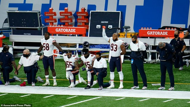 Chicago Bears Roquan Smith (58), Josh Woods (55), Joel Iyiegbuniwe (45) and James Vaughters (93) listen during the national anthem before their NFL football game against the Detroit Lions in Detroit