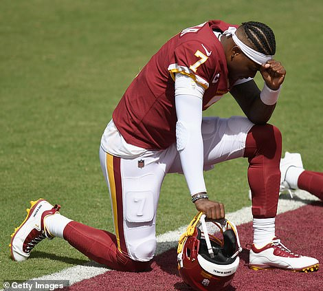Dwayne Haskins #7 of the Washington Football Team takes a knee before the game against the Philadelphia Eagles at FedExField on September 13 in Landover, Maryland