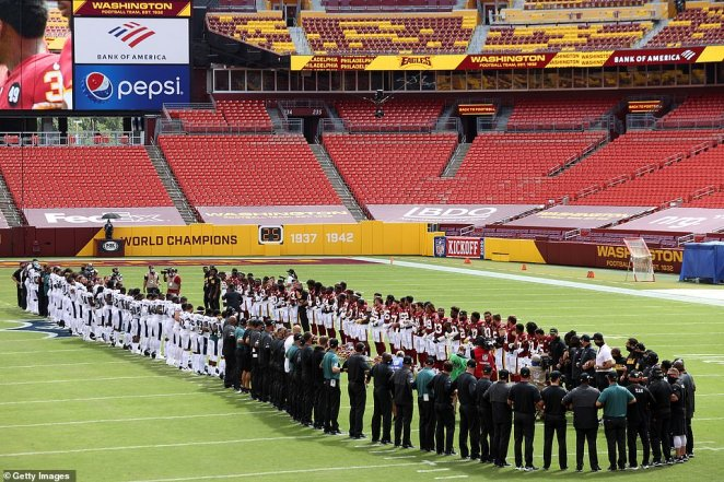 Teammates and officials from theWashington Football Team and the Philadelphia Eagles stand together before the game