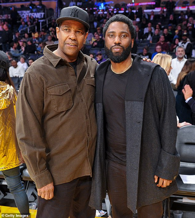 Back with the 'rents: John David Washington briefly moved back home with his famous dad Denzel Washington and mom Paulette amid the looming coronavirus pandemic; Denzel and John David pictured in 2018