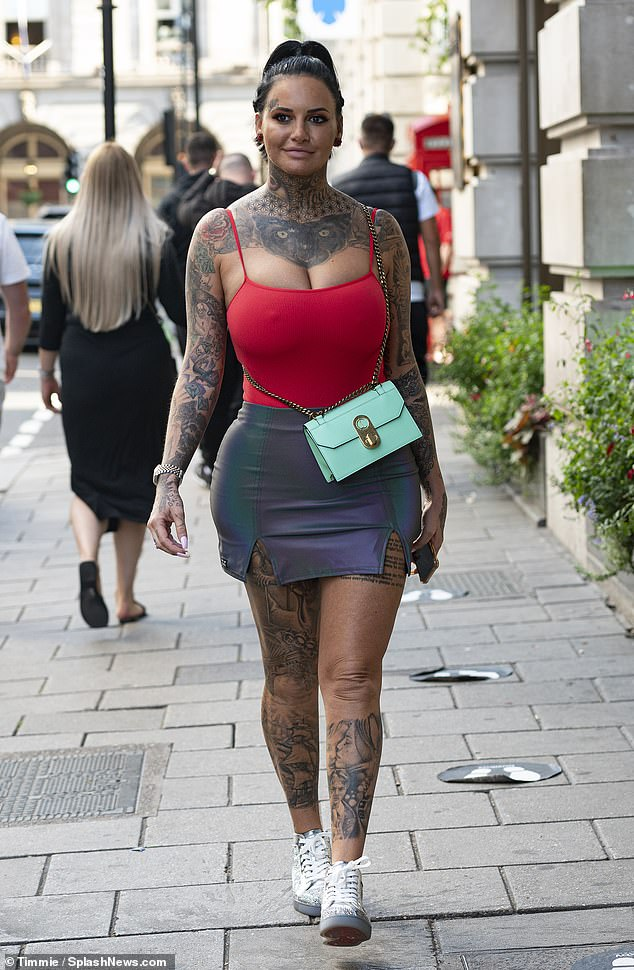 Strut your stuff: Jemma Lucy commanded attention once more in a scarlet top and mini skirt as she headed out for lunch in Mayfair on Sunday afternoon