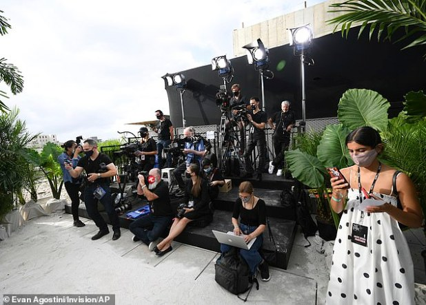 Staying safe: press and photographers were seen wearing masks, capturing each model during Sunday's show