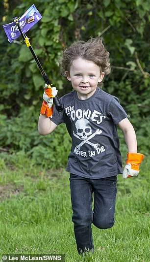 Determined to keep his hometown clean, six-year-old William Sharkey (pictured) rarely leaves the house without his litter-picker and bin bags