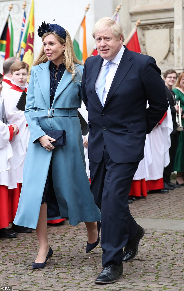 Prime Minister Boris Johnson and partner Carrie Symonds leaving after the Commonwealth Service at Westminster Abbey, London on Commonwealth Day in March this year