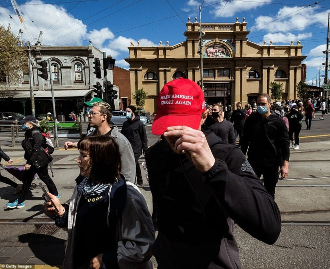 A Melburnian wearing a 'Make America Great Again' hat attended a protest at the Queen Victoria Market on Sunday
