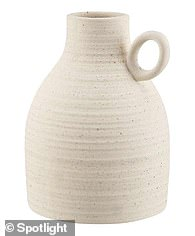 A $17.50 white bud vase is on sale down from $25