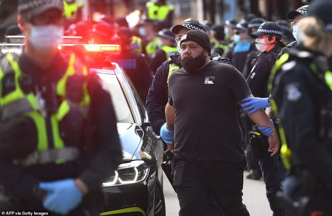 Police arrest another protester near the Queen Victoria Market on Sunday