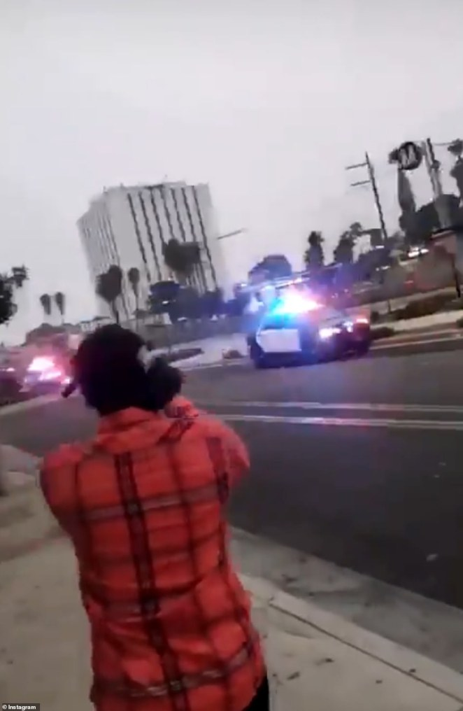 Bystanders filmed as the officers rushed to the aid of their injured colleagues, shot by a gunman in an unprovoked attack