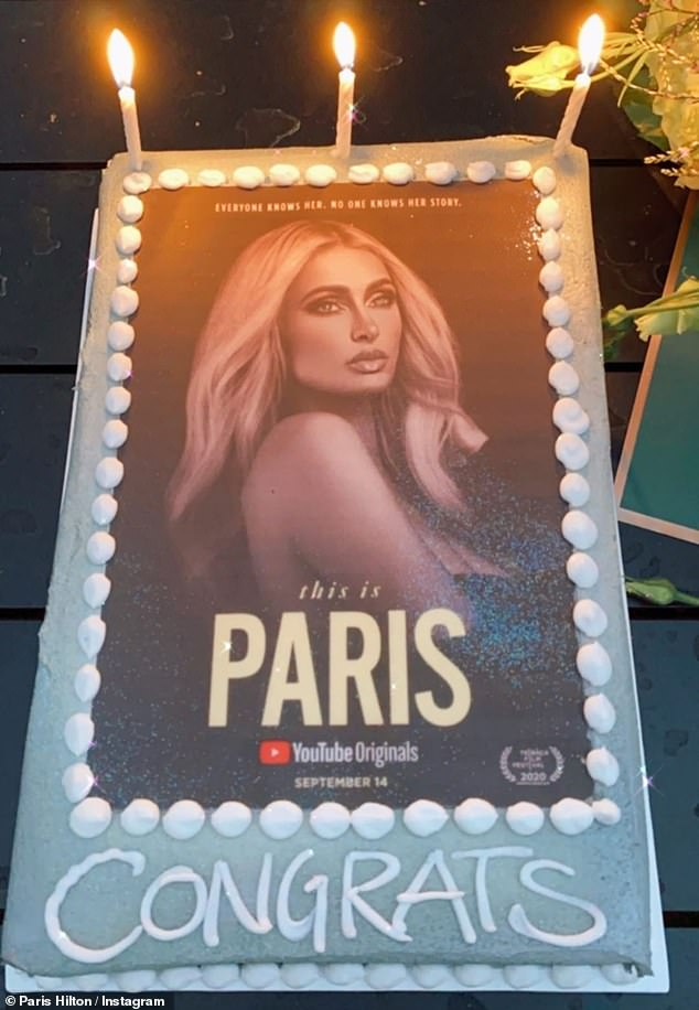 Make a wish: Paris also posted a video of silver cake, which was printed with the promotional image for the documentary and 'congrats' in white icing