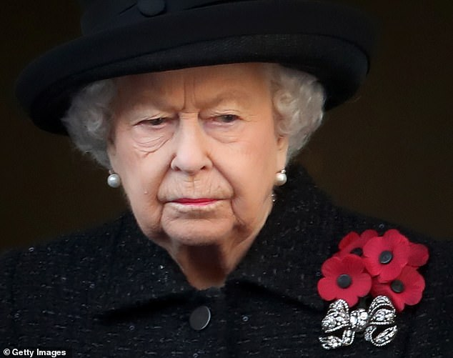 Queen Elizabeth II, picture at last year's Remembrance Sunday event, will be at the Cenotaph on November 8 'come hell or high water,' Royal sources said