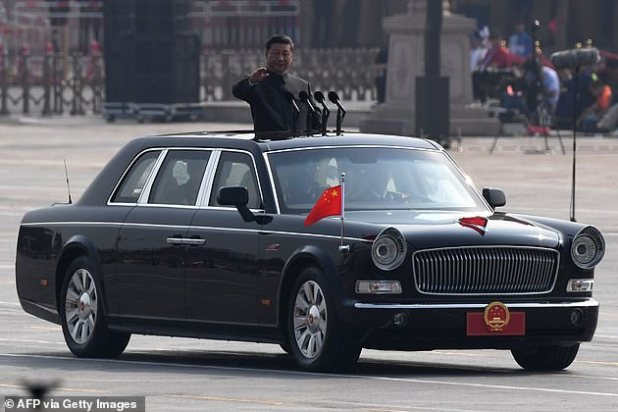 Chinese President Xi Jinping reviews soldiers from a car during a military parade at Tianmen Square in Beijing