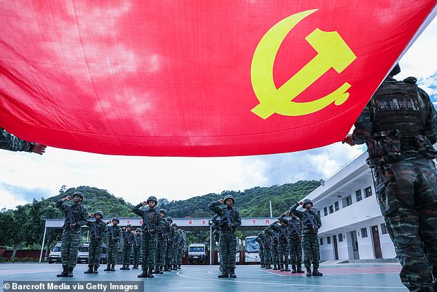 Regional alliances are building as the rise of China and its push into the Pacific alarms both Washington and the Indo-Pacific nations. Pictured: Chinese Communist Party members swear allegiance to China's ruling party on June 28 in Yunnan Province