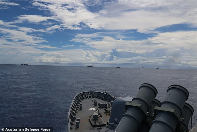 Regional powers are training together, alarmed by China's increasingly aggressive stance in the Pacific. Pictured: joint naval manoevres on Wednesday near Guam
