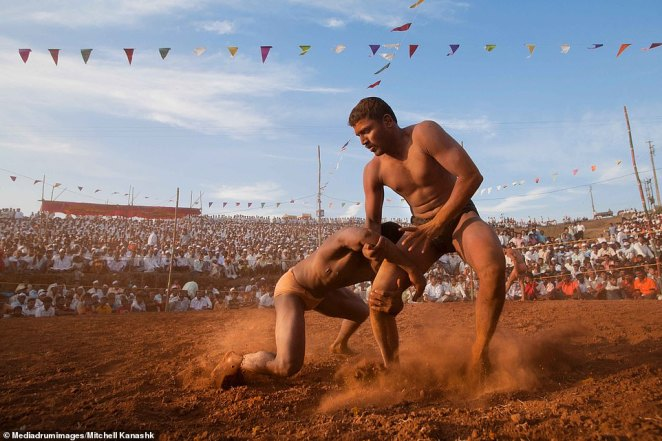 Several thousand spectators watch in the stands as teenage fighters competed for the title of kushti champion in Kolhapur, India