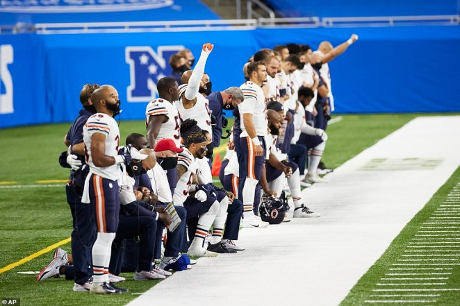 Chicago Bears players on the sideline during the national anthem against Detroit Lions during an NFL football game, Sunday