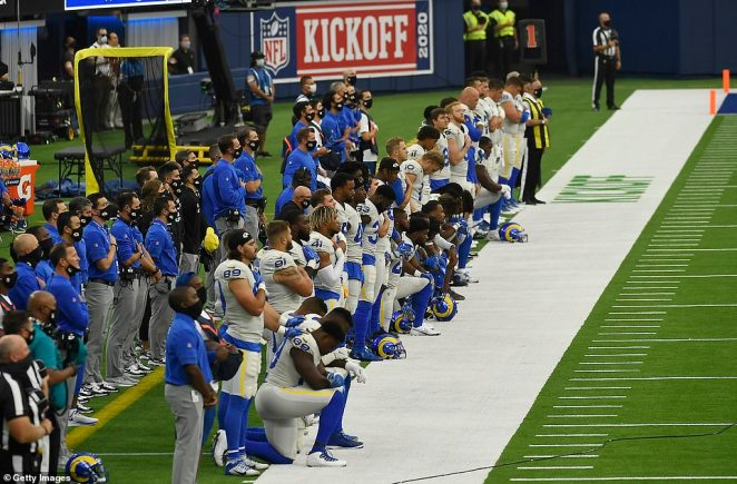 The Los Angeles Rams sideline during the national anthem before the game against the Dallas Cowboys at SoFi Stadium on Sunday