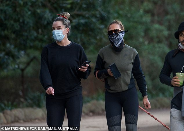 Melbournians have been prohibited from leaving home for non-essential reasons since stage four restrictions were implemented on August 2. Two masked women are seen walking near the Tan in Melbourne last month