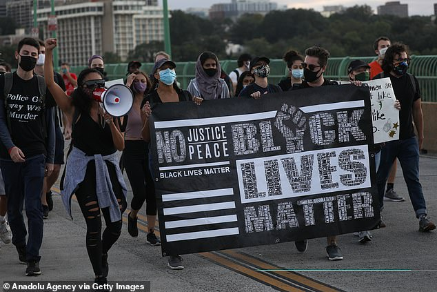Los Angeles-born Patrisse, 36, founded Black Lives Matter in 2013 with Alicia Garza and Opal Tometi, after they were driven into action following the acquittal of George Zimmerman, who was accused of killing Trayvon Martin in Florida in 2012. Pictured: Black Lives Matter demonstrators march along Key Bridge in Washington D.C. on Saturday