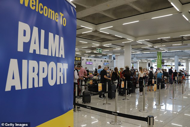 Britain has been knocked off its traditional top spot as Spain's most important foreign tourism market for the first time in decades. Above, a view of Palma de Mallorca airport in July