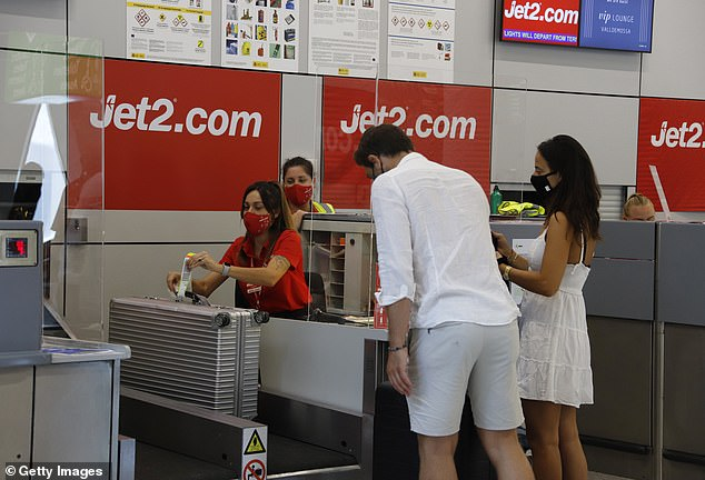 The UK has been Spain's most important foreign tourist market for decades after it began to open up to northern European holidaymakers as a sun and sea destination under former dictator Francisco Franco. Above, passengers queue at the Jet2 check-in desk at Palma de Mallorca