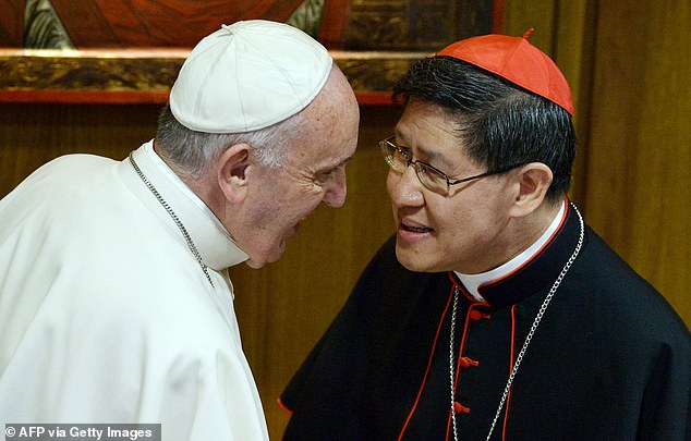 Philippine cardinal Luis Antonio Tagle, 63, had a private audience with Francis and went on to test positive for Covid-19. Above, Cardinal Tagle pictured with Pope Francis in this 2015 file image