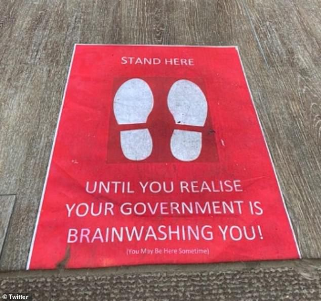A red doormat with white footprints at the entrance to J.Voke Vintage Tearoom in Chichester also instructs customers to 'stand here until you realise your Government is brainwashing you'