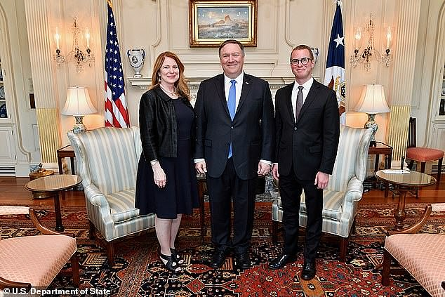 Mike Pompeo caused an internal fracas at the CIA when he and his family - wife Susan and son Nicholas are seen in a 2018 State Department photo - stayed at 'The Farm' for Christmas 2017