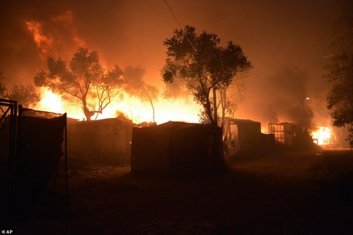 Fire almost completely destroyed Moria, the largest migrant camp on the Greek island of Lesbos, leaving more than 12,000 asylum seekers without shelter