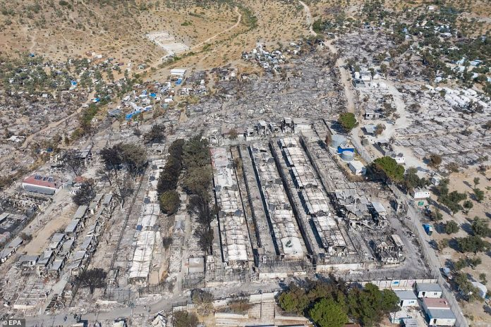 Prime Minister Kyriakos Mitsotakis said on Sunday that Greece would build a permanent new migrant reception centre to replace the Moria facility. Destroyed refugee camp pictured above