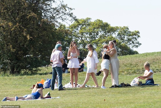 Primrose Hill in north London saw groups over over six join together for a day out in the sunshine on the Rule's first test