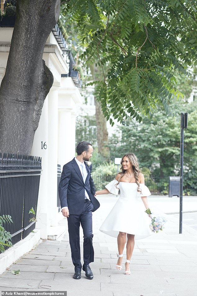 Look of love: Aruna and Thomas joke as they stroll down the street on their wedding day