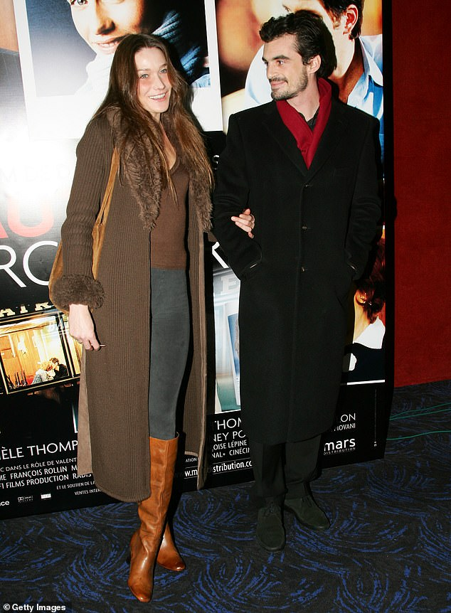 Carla Bruni, who shares a son with Raphaël, stands out in how she is praised in the book. Her character Beatrice is described as the 'ideal woman'. Pictured, the couple in Paris in 2006
