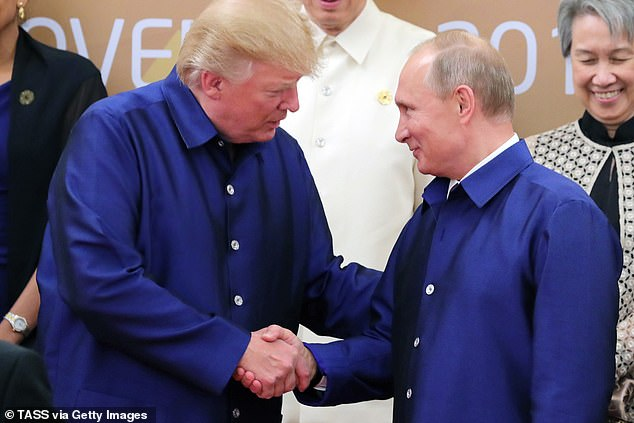 Trump's (left) relationship with Russian President Vladimir Putin (right) is also scrutinized in the book, with former Director of National Intelligence Dan Coats telling Woodward he was suspicious that Putin 'had something' on Trump, but never found solid evidence