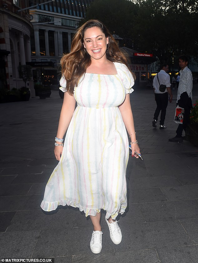 Ray of light: Kelly looked sensational in a floaty summer dress as she walked along