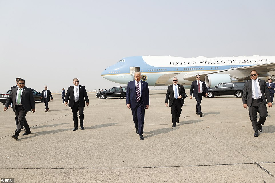 Arrival: Donald Trump heads to speak to reporters after landing at Sacramento McClellan Airport, which doubles as an air force base for the California National Guard