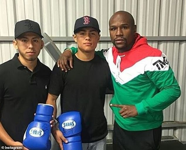 Gonzalez (center) signed with Mayweather's TMT promotion in 2016 when he was just 18, indicating his status as one of the sport's rising stars