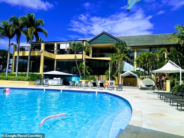 The AFL bubble in Carrara on the Gold Coast has been a point of contention after photos surfaced of WAGs and officials sipping alcohol by the pool while ordinary Australians were being turned around at the border. Pictured: The Mercure Gold Coast
