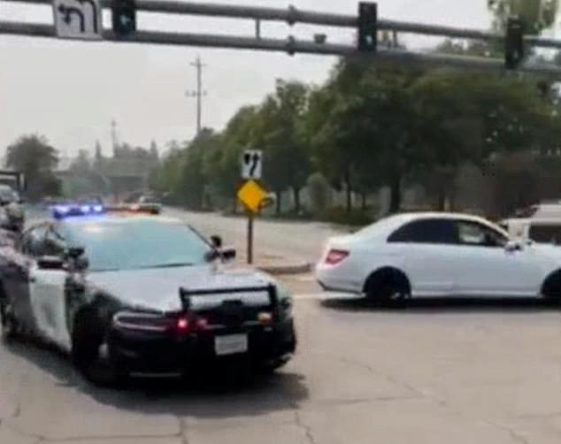 The officer driving decided to suddenly speed up causing the man topple off