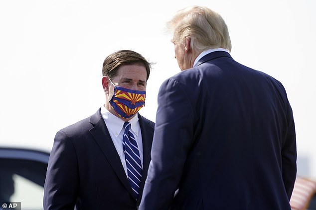 President Donald Trump is greeted by Arizona Gov. Doug Ducey at Phoenix Sky Harbor International Airport - Ducey wore a face mask for the greeting