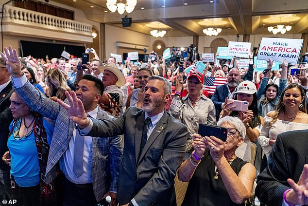 Arizona forbids gatherings of more than 50 people and the city of Phoenix requires face masks; above are supporters at Trump's Latinos for Trump roundtable