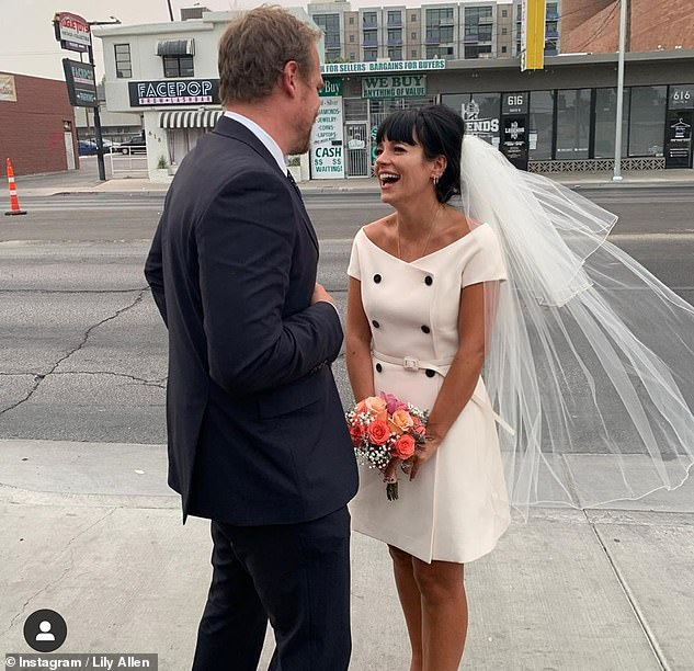 So happy: The British singer, 35, exchanged vows wearing a short 60s-inspired Dior dress with bateau neckline and veil. It's her second marriage and his first