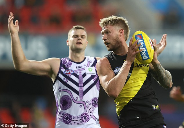 Game on:Most of the AFL season for 2020 has been played in Queensland, where hubs were set up throughout the state from Cairns to the Gold Coast to allow teams to play against one another in spite of COVID-19 restrictions. Pictured: Nathan Broad of the Tigers this month