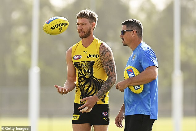 End in sight:Queensland will host the 2020 Grand Final on October 24 at the Gabba in Brisbane following a deadly coronavirus outbreak in Victoria. Pictured: Nathan Broad with team staff during a Richmond Tigers AFL training session on Gold Coast on August 20, 2020