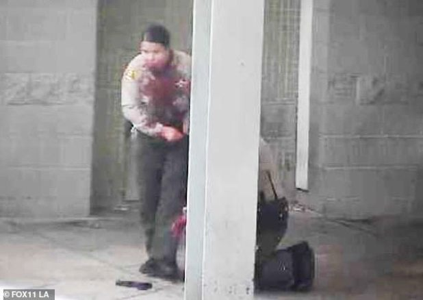 Pictures have surfaced of the wounded LA deputy, shot in the jaw, assisting his partner